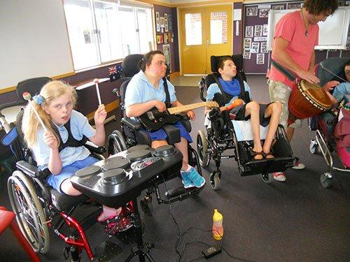 Students enjoying a music workshop
