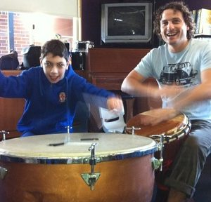 Playing the drum with drumsticks